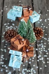 Christmas gifts (Speleolog) Tags: present decoration holiday gift christmas season xmas ribbon decorative box festive winter celebration branch wooden tree new background card year seasonal advent fir decor ornament greeting bow merry tradition berry green bauble vintage pine decorate celebrate rustic wood snow december light package cone evergreen beautiful star pinecone brown teal blue