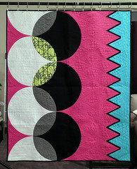 The Cool Kids 1 (Quiltachusetts - Heather Black) Tags: modern contempory quilt shocking hot pink aqua blue gren black white solids curved curves triangle transparency walking foot straight line quilting geometric