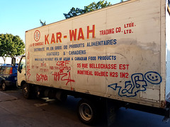 Kar Wah Trading Co. (Exile on Ontario St) Tags: kar wah trading co company montreal bellechasse karwah compagnie camion truck old vieux ancien ancient graffiti stationn parked stationnement parking white chinese characters writing letters writings produits alimentaires distributeur distributeurs food grossistes grossiste import export importateur exportateur wholesale smileyface smiley face asian asiatique asiatiques canadiens canadien commerciale vandalized vandalism vandalisme rosemont petite patrie petitepatrie lapetitepatrie montral rue street chinois kw commerce business trade corporate