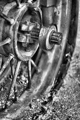Returned (wesleyramsey) Tags: wheel rustic rust old sunken vintage blackandwhite sony sonynex5t supertakumar50mm takumar 50mm14 nex