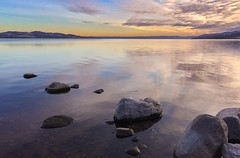 Reflection (Tom Dalhoy) Tags: ifttt 500pxrtg 500px sun winter sky water blue green light clouds red smooth stone shore daylight iphone