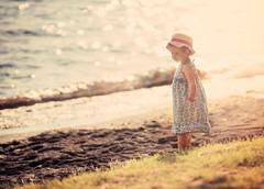 Bathing in the sun [EXPLORED] (Wojtek Piatek) Tags: blue sunset summer portrait italy sun lake reflection girl grass hat out golden kid haze sand focus child dress sony tuscany flare hours volcanic strawhat bolsena lazio a99 zeiss135