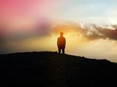 Silhouette of Person Viewing Colorful Sky (Image Catalog) Tags: sky color silhouette clouds person colorful solitude thought alone outdoor philosophy science human contemplation psychology publicdomain