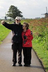 Don & Shari at Kinderdijk IMG_0545 (SunCat) Tags: travel cruise vacation holland netherlands windmill canon river europe all windmills powershot don shari viking kinderdijk 2015 g3x