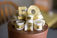 Chocolate & Gold 50th Anniversary Cake (Grace-ful Cakes) Tags: anniversary 50thanniversary anniversarycake chocolatebuttercream diamondpattern 50thanniversarycake gumpastebow golddragees goldlusterdust goldribboncake goldfondantribbon