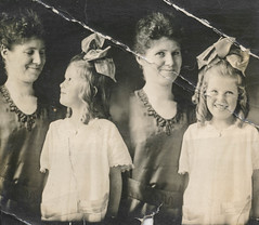 Loving mother and daughter photo strip portrait (simpleinsomnia) Tags: old white black cute love girl monochrome smiling loving vintage booth studio found photo blackwhite kid photobooth child little antique grunge snapshot daughter mother photograph bow littlegirl vernacular damaged foundphotograph creased