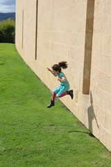 A running jump (Lorni Mouse) Tags: ponytail grace midair suspended window jumping jumps girl child