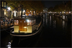 Prinsengracht (steeedm) Tags: amsterdam canal houseboat lights nighttime trees autumn leaves