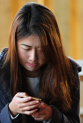 The Addiction (thepoocher7) Tags: texting cellphone socialmedia addiction streetphotography electronics communication people portrait prettygirl asiangirl dyedhair bitinglip goldphonecase blue jacket outdoor candid cutegirl concentration enveloped sunlight beautifulhair expression