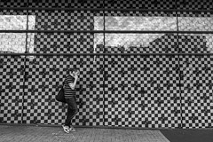Squares (Howie Mudge LRPS) Tags: man walk walking wall pavement mobile phone talking talk candid casual portrait reflection glass pattern street streetphotography streetlife urban urbanphotography cardiff caerdydd wales cymru uk travel travelling traveler outside outdoors capital city compactcamera sonydscrx100m4
