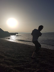 Skipping Stones (katieentwistle) Tags: holiday crete greece stone skipping silhouette sun beach sea ocean water pebbles throwing action
