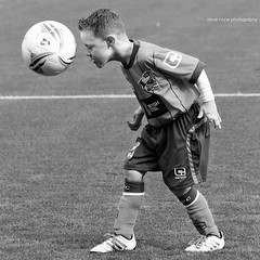 Scunthorpe United mascot v Sheffield United 2016 (SteveH1972) Tags: blackandwhite person child canon70200 canon700d 700d sport sportphotography sportsphotography actionphotography action kid kids scunthorpe scunthorpeunited scunny monochrome northlincolnshire northernengland lincolnshire lincs england uk europe world football footy soccer mascot 11 glanfordpark ball bw people 2016 britain 70200 llens footballshirt shirt sufc iron united
