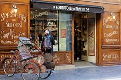 gourmandises (overthemoon) Tags: france aquitaine bordeaux ruestecatherine buildings façades architecture windows lettering épicerie food specialities wheels explore 130