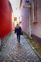 Walking through Helsingor, Denmark (` Toshio ') Tags: toshio helsingor elsinore denmark danish girl woman walking alley city cobblestone history sunlight blonde fujixe2 xe2