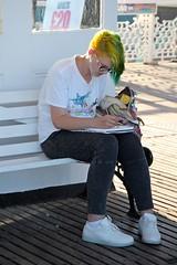 Artist at work (Carol Spurway) Tags: brighton pier palacepier earphones artist green yellow hair
