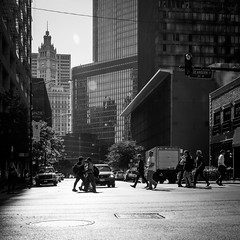Work parade (dharder9475) Tags: 2016 architecture bw blackandwhite buildings chicago crosswalk dearbornstreet morning people privpublic rivernorth square streetphotography sunrise sunshine walking
