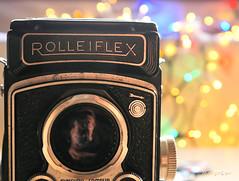Little Arrow ... (MargoLuc) Tags: macromondays theme arrow rolleiflex camera analog vintage black bokeh colourful festive mood lights reflection macro monday