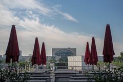 bundeskanzleramt with red umbrellas (Winfried Veil) Tags: berlin umbrella germany deutschland 50mm umbrellas summilux winfried kanzleramt schirme bundeskanzleramt 2015 sonnenschirme sonyalpha systemkamera winfriedveil sonyalpha7rii sonyalpha7rmarkii