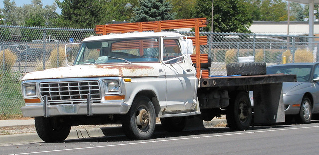old white classic ford truck vintage rust rusty pickup pickuptruck rusted oxidation vehicle 1970s custom 1979 survivor jalopy beatup junker beater madeinusa americanmade flatbed rustyandcrusty 2wd fullsize f350 oxidized fomoco 1ton dually worktruck stakebed farmtruck eyellgeteven