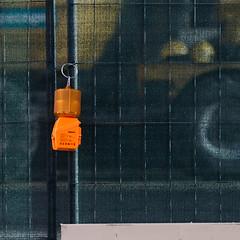 The orange lamp (zeh.hah.es.) Tags: orange black yellow fence schweiz switzerland construction zurich baustelle gelb zrich zaun constructionsite schwarz kreis5 hardbrcke bauzaun zehhahes