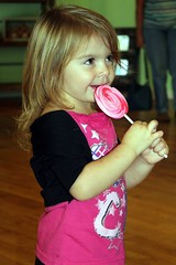 Girl and her sucker (PhotoJester40) Tags: littlegirl sucker pink candy smiling inside indoors female 2yearold amdphotographer