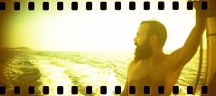 film (La fille renne) Tags: film analog 35mm lafillerenne sprocketrocket lomographyxpro200 xpro crossprocessing sea roadtrip landscape portrait man portcros boat