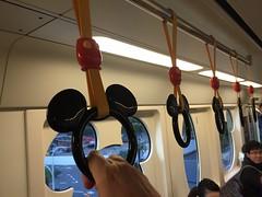 Riding the Disney Metro Line (jericl cat) Tags: station subway handle tokyo disneyland ears mickey transit ear monorail grasp meihama