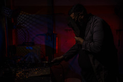The Blacksmith (Rober Lucero) Tags: light dark low key lowkey red blue blacksmith herrero flash fire