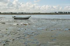 tidal flats alongside Mount Saint Michel, Normandy, France (tcd123usa) Tags: italyparislondon2016 leicadlux4 mountsaintmichel normandy france rowboat skiff tidalflats