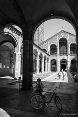 Milano_Sant'Ambrogio (sgarzulino) Tags: blackwhite bw samyang 10mm nikon d5000 milan milano itali santamprogio architecture church basilica people bicycle