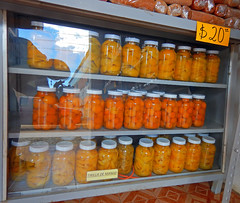 Canned fruits in a shop window in Talpa, one of Mexico's Pueblos Magicos in the Pacific high sierras (albatz) Tags: sierramadre westcoast buildings talpa mexico pueblosmagicos pacific high sierra bright cannedfruit fruit orange jalisco town
