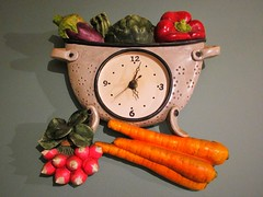 A colourful colander clock (JulieK (finally moved to Wexford)) Tags: colander clock vegetables carrots kitchen wall 2016onephotoeachday canonixus170