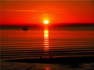 Fishing boat in the sunrise