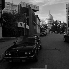 298/365 (local paparazzi (isthmusportrait.com)) Tags: street shadow blackandwhite white black detail blancoynegro blanco car skyline architecture contrast corner buildings square point iso800 pod downtown shoot little parking capital negro grain streetphotography capitol dome intersection parked madisonwi noise rotunda tornado squared recovery tornadoroom f42 sharpness 2015 isthmus littlecamera 365project danecountywisconsin photoshopelements7 pse7 localpaparazzi redskyrocketman lopaps isthmusportrait ricohwg30