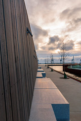 Looking out (powerdook) Tags: ocean wood morning trees light sea water look stone wall clouds bench golden harbor harbour path cranes wharf lamps aarhus sikies
