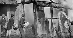 A real building to set fire to (theirhistory) Tags: boy building water fire kid bucket shoes child burning jacket shorts wellies firemam