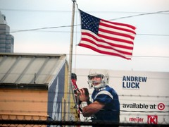 The Stars and Stripes fly over Andrew Luck. (kennethkonica) Tags: city blue red food usa white signs color chicken america canon stars football midwest flickr random stripes indianapolis flag indiana americanflag billboard communication pizza signage kfc starsandstripes global hoosiers canonpowershot oldglory colonelsanders marioncounty andrewluck kennethkonica