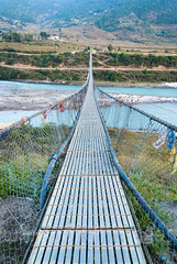 Suspension Bridge (whitworth images) Tags: landscape bridge himalaya water himalayas long hills bhutan valley suspension travel longest blue rural river punakha over crossing glacial asia outdoors above steel village hanging metal punakhadzongkhag