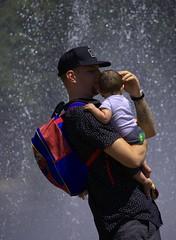 Fatherhood (swong95765) Tags: father man child caring nurturing water fountain sunshine loving baby kid nurture