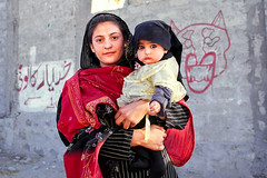 A girl with a big-eyed baby, Gilgit, Pakistan (inchiki tour) Tags: travel photo film pakistan     people girl kids baby pakistani  gilgit