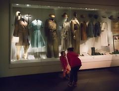 Big sister explains (Brian Negus) Tags: uniforms imperialwarmuseum displaycase womeninwar salford children salfordquays