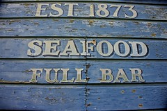 EST. 1873 (sswj) Tags: signage oldsign seafood fullbar marshall northerncalifornia california tomalesbay westmarincouinty established1879 historic weathered composition dslr fullframe scottjohnson marincounty nikon d600 nikkor28300mm availablelight existinglight naturallight blue lettering abstractreality architecturaldetail