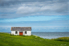 The little house by the sea (janne.skei) Tags: house sea seascape landscape alone clouds architecture outdoor old norge norway grass field color cottage water sky minimalistic beautiful panasonic lumix lumixfz1000 fz1000 raw background white blue green ngc