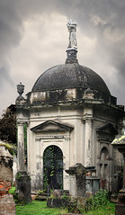 Crypt (Seeing Visions) Tags: 2016 mexico mx jalisco guadalajara pantendebeln pantheonmuseumofbethlehem santapaulacemetery crypt architecture grave headstone pillar urn sculpture dome woman standing grass sky clouds raymondfujioka