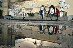 Balancing (Päivi ♪♫) Tags: oslopeacecentre mural pool reflection balance street oslo norway wire boys