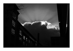sunrays in urban darkness (rainbowcave) Tags: clouds sun beams bw urban wolken sonnenstrahlen rays windows reflection