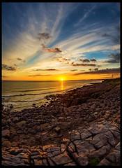 Porthcawl (Fatdeeman) Tags: ocean sunset sea summer sun beach wales lens golden bay fishing sand dusk south hour lensflare flare rest fishingboats bouys goldenhour bridgend porthcawl flaring restbay
