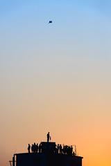 Sakrain 2015 (AvikBangalee) Tags: sky people kite rooftop silhouette festival fire evening lifestyle celebration flame bluehour dhaka tradition bangladesh fireball firebreathing kitefestival harvestfestival olddhaka kiterunners avikbangalee peopleandliving sakrain chaitrashangkranti shangkran