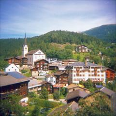 fiesch (thomasw.) Tags: street travel 120 analog schweiz switzerland holga europa europe cross suisse suiza mf wallis valais crossed fiesch