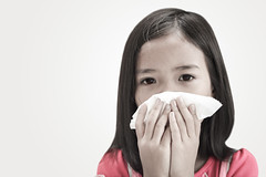 Asian little girl flu cold or allergy symptom. (By Jan_) Tags: pink woman cold girl face paper asian thailand handle nose kid pain asia child hand close little tissue breath your strong obstruction bent sick puke ones flu influenza smelly snot sneeze hold nasal vomit concealed infection allergy odor ache cough sinus stink stench pungent inflammation grippe malady immunocompromised